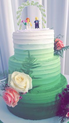 My friend's wedding cake.  June 2015.  Green ombre frosting to represent the Irish heritage of the Groom - Lemon sponge and buttercream frosting -  Lego pieces as cake toppers.