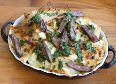 Steak Chimichurri Nachos! What isn't delicious w/ chimichurri, gooey cheese and steak! YUM!