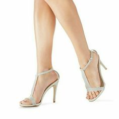 Sexy t-strap heels Set the new spring standard in Tinley. She?s a hot heeled sandal featuring a sleek translucent gray PVC t-strap and matching heel for a chic minimalist effect. JustFab Shoes Heels