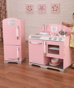 With our Kidkraft Pink Retro Kitchen and Refrigerator set, kids can cook up feasts for the whole family. The Kidkraft Pink Retro Kitchen and Refrigerator set is made of wood and the refrigerator, freezer, oven and dishwasher all open and close. Play Kitchens, Play Kitchen Sets, Cool Kitchens, Toy Kitchen, Toddler Kitchen Set, Pretend Kitchen, Retro Kitchens, Country Kitchens, Kitchen Gifts