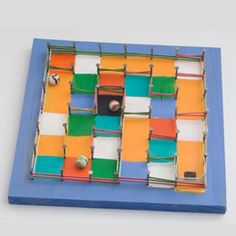 A pegboard and rubber band marble maze. You can change the difficulty of the maze easily by moving the rubber bands. Scout Activities, Preschool Activities, Easy Crafts For Kids, Diy For Kids, Marble Maze, Homemade Toys, Crafty Kids, Rainbow Loom, Cub Scouts