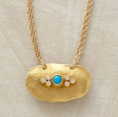 "This is a stunning necklace. Turquoise and diamonds stud and ""ancient amulet"" in gold. 15-16"" gold fill chain. Sundance"
