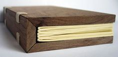 wooden boards with 45 degree hinges, use cloth or metal hinge, and 3 ring binder ring to hold pages