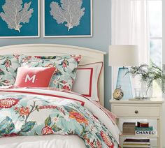 Blue bedroom with pink coral accents