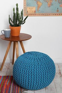 Cable Knit Pouf - I have 2 of these for my livingroom. One blue and white and the other orange. They add so much texture and fun to the room and they are great to use to put your feet up.