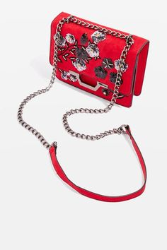 We're in love with this sequin suedette body bag. The rich red adds a hit of colour to a monochrome outfit and the chain strap really adds some edge.