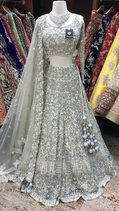 White Crystal Embroidery Lehenga - White net heavy bridal lehenga with silver and pearl embroidery. This piece is a showstopper! Fabric- Net Color- White Occasion- Wedding Reception Blouse- Chest Length Skirt- Waist Length Source by - Indian Wedding Gowns, Indian Bridal Outfits, Indian Gowns Dresses, Indian Bridal Fashion, Pakistani Bridal Wear, Wedding Reception Gowns, Indian Reception Outfit, Crystal Wedding Dresses, India Wedding