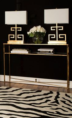 Gold, Black and White Foyer Elegance Elegant foyer with dramatic elements: Zebra print rug, gold table and lamps and black walls! Design Entrée, Deco Design, House Design, Design Trends, Lobby Design, Design Model, Foyer Decorating, Interior Decorating, Decorating Bookshelves