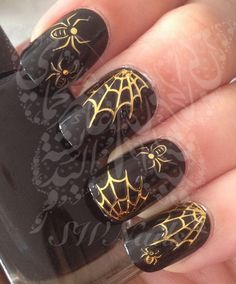 Gold Spider Web on Black Nail Polish.