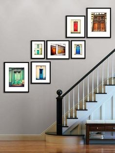Here is a great solution for your stairway wall. The layout of the frames steps up the wall at the same angle as the railing.