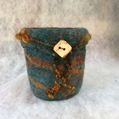 Wool vessel with mohair trim and a coconut button