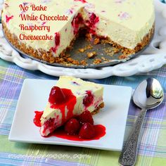 This SUPER-EASY luxuriously sumptuous NO BAKE CHEESECAKE is truly the ultimate dessert for the holidays! Paired with a sweet-tangy raspberry sauce makes it even more luscious. Enjoy! #easy #recipe #nobake #white #chocolate #raspberry #cheesecake