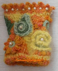 A freeform crochet cuff, bracelet, wrist warmer, Boho style, in different yellow, green and orange colours. I have used yarns of merino wool and mohair and worked in white beads.  My creations are all one of a kind.  The outside measurements are aprox.:  Width 10 cm Length 15 cm  Caring for your item: gentle hand wash in mild soap, press carefully out excess water & allow to air dry   Please ask for shipment costs outside of the UK.  Feel free to email me with any questions.