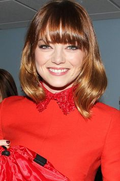 Heavy bangs are a great way to balance out a round face. Emma Stone embraces the curve of her circle face with this tucked under bob and heavy-set fringe. Haircuts For Round Face Shape, Bangs For Round Face, Face Shape Hairstyles, Long Hair With Bangs, Hairstyles For Round Faces, Hairstyles With Bangs, Wavy Hairstyles, Short Haircuts, Medium Hair Cuts