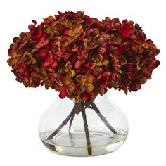 Hydrangea with Vase Silk Flower Arrangement | Nearly Natural | Petite blooming hydrangea bundles in brilliant autumnal colors welcome the new season. Handcrafted and finely shaped, the mixed hues of this arrangement mimic a true hydrangea. With leafy green stems and faux water vase, this arrangement is ready for display. Place the flowers next to candles and books for the perfect coffee table vignette.