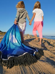 Grab a friend and your Blue Lagoon Round Towel. Then head to the beach.