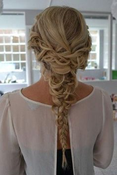 Create loose French braids from one side to the other for this braided updo.