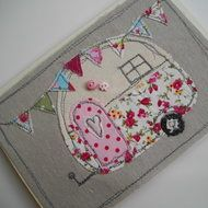 A very pretty machine embroidered textile card, a retro caravan with bunting using quality fabrics and linen, two small buttons to finish.  A6 size card and will arrive cello wrapped.