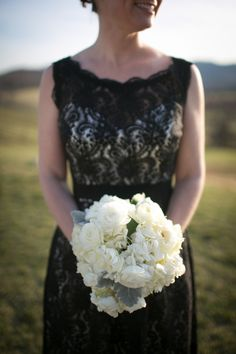 Black lace bridesmaids dress and cream floral and dusty miller bouquet by http://www.patsfloraldesigns.com/ | photography by http://kristengardner.com