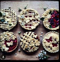 pie crusts: six small pies with butterfly cut outs and braided borders Thanksgiving Cookies, Köstliche Desserts, Delicious Desserts, Dessert Recipes, Plated Desserts, Creative Pie Crust, Beautiful Pie Crusts, Pie Crust Designs, Pie Decoration
