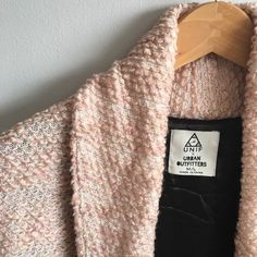 Unif X Urban Outfitters Cardigan Unif x Urban Outfitters exclusive tags attached. So, I bought this from a seller on here and I really wanted this to fit like a cute oversized look. But unfortunately it's not at all cute on me because I'm too petite for this and I wanted this so bad. So I'll trade for a size S/M or any other Unif. I'll sell for $50 because I need the money anyways. UNIF Jackets & Coats