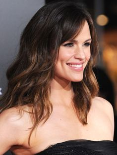 """To achieve this look, spritz a volumizing spray on hair before setting in large hot rollers. Straighten out the bangs with a flat iron, and then brush out curls with a boar-bristle brush. Run your fingers through the curls for a natural look. Set with hairspray. """"This style is so natural, it's as if she is just that girl who has great hair with no effort!"""" says Stephens.    Read more: Long Celebrity Hair - Celebrities with Long Hair - Woman's Day"""