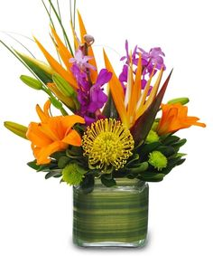 This glass cube arrives brimming with tropical flowers. The assortment includes orchids, birds of paradise and protea. The vase is lined with tropical foliage. We deliver nationwide! Exotic Flowers, Tropical Flowers, Silk Flowers, Beautiful Flowers, Tropical Colors, Spring Flowers, Tropical Birds, Cactus Flower, Lilies Flowers