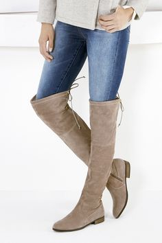 Taupe suede over-the-knee boots with flirty back ties
