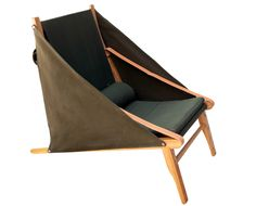A de T 'Bivouac' lounge chair -  wood frame & Sunbrella canvas upholstered seat & side panels. Leather straps included. Comes in green, blue, burgundy, yellow and natural.