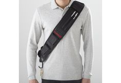 "Organized traveller shoulder pack, $39.99 at Sharper Image. You will look like a total geek, but, ""you can use this shoulder pack while running, hiking, cycling, dog-walking or even for hands-free shopping. Worn from shoulder to hip, it carries your smart phone, keys, mp3 player, camera, glasses, snack, wallet – even a water bottle. Rear reflector adds safety. No slip, contoured shoulder strap is ergonomic; distributes weight evenly for comfort."""