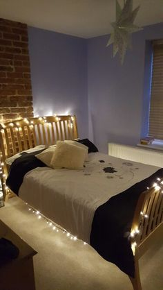 Space saving ideas for a small bedroom; no need for a lamp just pimp out the bed with fairy lights.