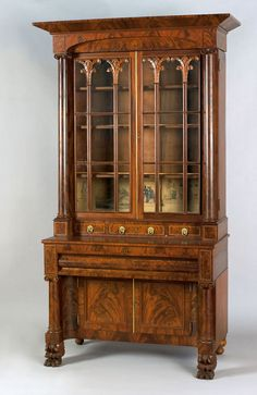 "Philadelphia classical mahogany five-part secretary bookcase, ca. 1825, with overall brass line inlays, the upper section with a molded cornice over 2 doors with carved mullions, flanked by turned columns, above 3 short drawers and 1 long drawer, resting on a lower section with 2 concave doors, supported by animal paw feet, 94"" h., 46 1/4"" w. Provenance: Collection of Thornton T. Perry."