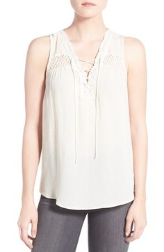 Free shipping and returns on Ro & De Lace-Up Woven Tank at Nordstrom.com. A gauzy woven tank is perfectly lightweight for warmer weather and full of pretty, feminine details, from the scalloped lace-up neckline to the floral-inspired lace insets and delicately dimensional shirring.