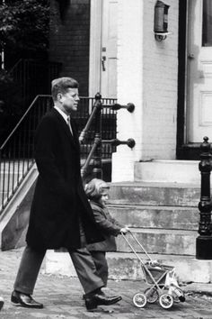 Jfk walks with Caroline on November 25,1960. Dad is telling she has a new baby brother