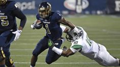 <p>FIU running back Alex Gardner (1), a Raines High graduate, slips away from Marshall linebacker Devontre'a Tyler (10) while carrying the ball in the first quarter as the FIU Golden Panthers defeated the Marshall University Thundering Herd, 31-14, on November 19, 2016, at FIU Stadium in Miami, Florida. (Photo by <strong>Sam Lewis, ImageReflex)</strong>  </p>