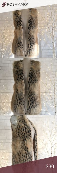 🌟faux fur vest The It girl must have faux fur sweater vest, perfect year round.   60% polyester 40% Acrylic.  Ⓜ️chest 40 Ⓜ️length 27  ✅Bundle and save  ✅🚭 ✅ all reasonable offers will be considered 🚫No Trading 🙅🏻 Poshmark rules only‼️ Xhilaration Jackets & Coats Vests