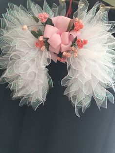 Angel Wings with Pink Rose florals designed by Amazing Wreaths 2018