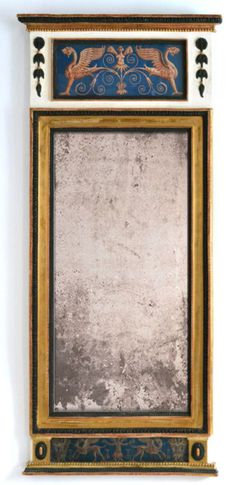 Swedish Gustavian mirror made around year 1800. Gilt and whitepainted wooden frame with a mirrorglass divided in two parts. This was the traditional way of constructing mirrors throughout the 18th and early 19th century. The top and the bottom of the mirror have eglomisé gouaches depicting griffins. Dim: 69.0 cm x 155.0 cm.