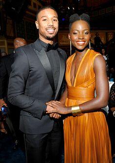 Michael B. Jordan and Lupita Nyong'o clasp hands at the NAACP Image Awards in Pasadena, CA on Feb. 22