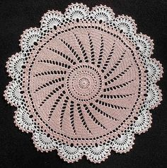 https://flic.kr/p/7uQGh3   Swirl Doily   Designer: Margaret Rost. Source: Leisure Arts Leaflet #702, Round Doilies. Thread: DMC Cebelia 10. Colors: #818 Baby Pink; #B5200 Brt. White. Hook: Clover ST #2/1.50mm. Size: 15.375 inches diameter. Made: September 26, 2008.  This is a beautiful, easy pattern to crochet.  I also made it in blue (Delft) and white for my niece, Veranda.