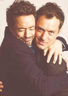 Robert Downey Jr. and Jude Law (Watson and Holmes) This is such a cute picture haha