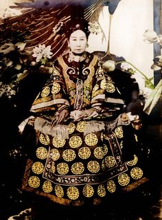A tinted photograph of the Empress Dowager Cixi, Regent of the Qing Dynasty. Her portraits included a painting given to Teddy Roosevelt...