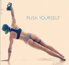 CrossFit Chicks with tattoos. Kettle bell obliques workout. Balance, yoga pose with weights.