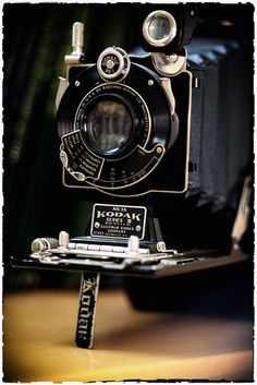 """My Grandfathers Kodak 1A. (   Captain Byron Cramblet )  He used it throughout WWII and the Berlin Airlift, eventually replacing it with a Kodak Retina II.  I am slowly scanning in his photo albums from 40's and 50's and fixing them up if possible in photoshop....  Shot with Canon 5D II w/ Vivitar Series 1 70-210   This was my first time using the Vivitar 70-210 and shot with the """"Macro Focusing Auto Zoom"""". It worked pretty well but was noticeably less contrasty than my Canon 70-200 f4 L."""