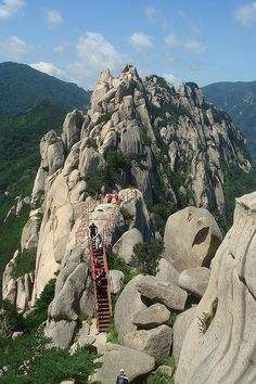 Climbing stairs to Ulsan Rock, Seoraksan National Park, South Korea (by wmdeneve). www.whywaittravel... @contreniatrvels on twitter Why Wait Travels on FaceBook #travelconsultant #travelspecialist