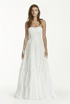 This crinkle chiffon wedding dress with lace appliques and ruffles is both elegant and fun!