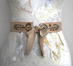 Original Steampunk leather belt sash Obi inspired, unique design by Elyseeart.  Materials & Technique: genuine nude leather waist belt, unique handcrafted design with natural amazonite beads, natural raw pyrite beads and industrial metallic applique. The belt is adjustable with leather strips tied in front, very comfortable to wear, perfect waist fit. Some areas are hand-painted for an artistic note. Each piece is hand-tailored and handcrafted. Waist: waist circumference form 29.5 to 33…