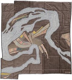leah evans is a textile artist based in madison, wisconsin. she makes quilts that are far from traditional.  she takes the imagery from maps, aerial photography   and satellite images. however she doesn't simply translate maps onto here quilts, instead she creates   imaginary lands uses elements from different maps.