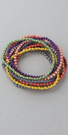 seed beads- cute, simple stretchy bangles, definitely cute stacked in multiples.: