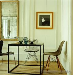 /\ /\ . Frédéric Méchiche . Paris Apartment . Dining Room . Four tables designed by Méchiche push together as one dining table. Chairs by Eames, Bertoia and Jacobsen.